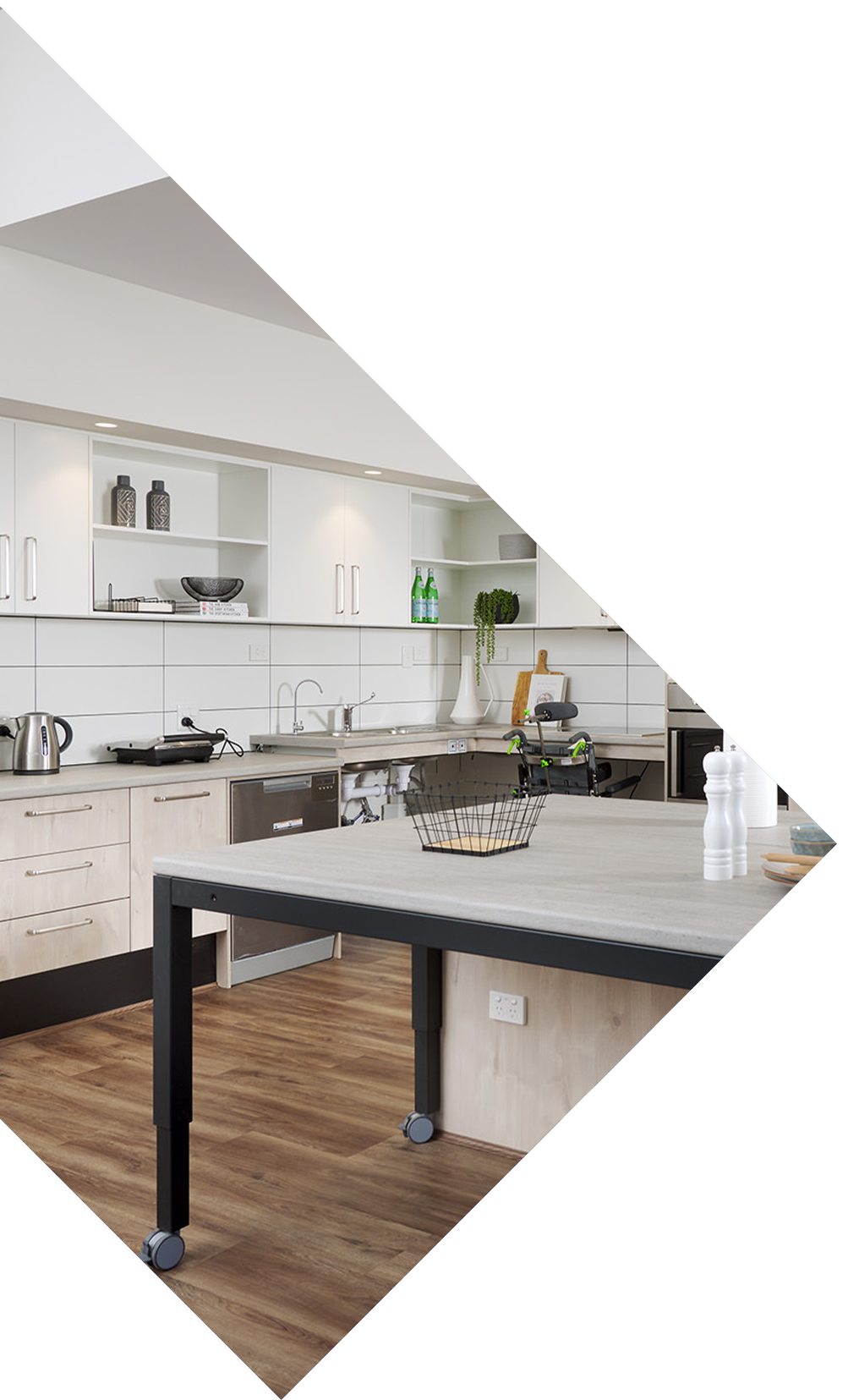 A stylish SDA approved kitchen appointed with custom features and wooden floors.